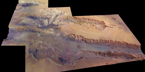 Een prachtige foto van het kloofsysteem Valles Marineris op Mars. Dit plaatje werd gemaakt op basis van beelden die de Mars Express tijdens tientallen rondjes rondom Mars verzamelde. Afbeelding: ESA / DLR / FU Berlin (G. Neukum).