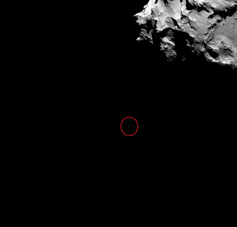 Een fantastische foto van de komeet en de lander (het stipje). Afbeelding: ESA.