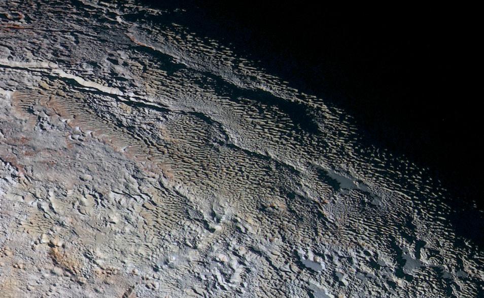 De slangenhuid van dwergplaneet Pluto. Afbeelding: NASA / JHUAPL / SWRI.