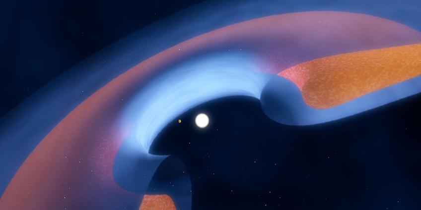 Deze artistieke impressie laat schematisch zien hoe het stof (bruin) en gas (blauw) rond de ster is verdeeld. Ook zie je hoe een jonge planeet het centrale gat schoonveegt. Afbeelding: ESO / M. Kornmesser.