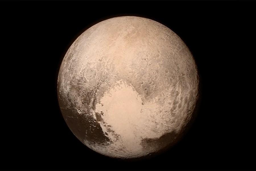 Het hart-vormige gebied op Pluto waar Sputnik Planum deel van uitmaakt. Afbeelding: NASA.