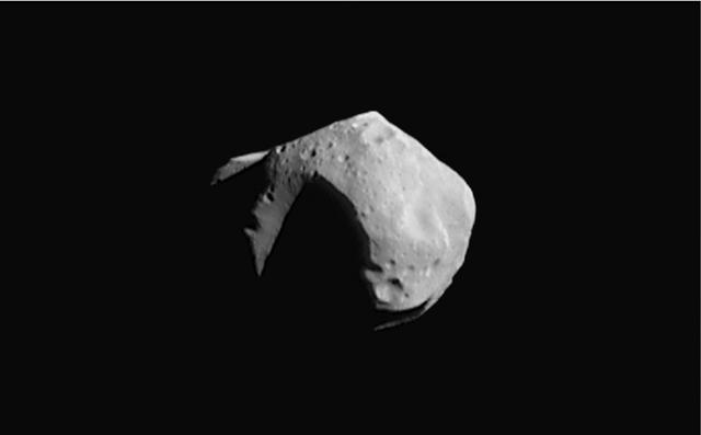 Planetoïde Mathilde: één van de weinige planetoïden waar we close-up foto's van bezitten. Deze planetoïde heeft een diameter van ongeveer 50 kilometer. Afbeelding: NASA.