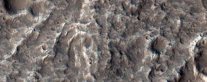De zuidwestelijke helling van Olympus Mons: de grootste vulkaan van het zonnestelsel (zo'n 25 kilometer hoog). Afbeelding: NASA / JPL / University of Arizona.