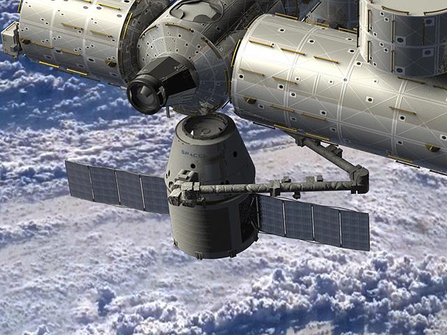 Dragon bij het ISS. Wist je trouwens dat de Nederlandse astronaut André Kuipers Dragon binnenhaalde toen deze voor het eerst een bezoek bracht aan het ISS? Afbeelding: NASA.